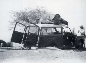 Alan Cooper's (East 1926) marooned car. Cooper, a failed Kenyan coffee planter and three associates set out in April 1955 from Nairobi in a Morris Traveller to drive across Africa, through the Sahara Desert and Europe to London.  The poorly planned expedition was to end in failure and his death